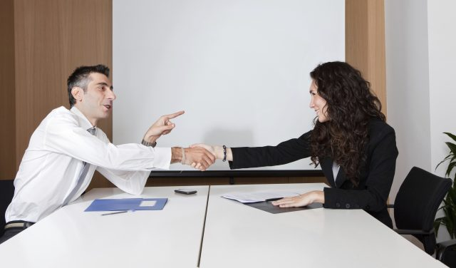 People shaking hands over a successful deal